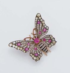 AN ANTIQUE RUBY, DIAMOND, GOLD AND SILVER BUTTERFLY BROOCH, 19th century