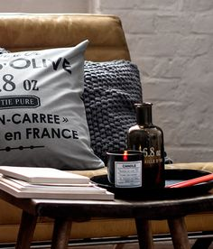 Pillows, candle, and glass jar from H's new home line http://www.cosmopolitan.com/celebrity/fashion/h-and-m-home-available-online