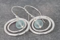 Sea glass hoops earrings ~ hammered silver hoop earrings ~ boho earrings ~ seaglass earrings ~ sterling silver earrings ~ beach jewellery by AmySquaredJewellery on Etsy https://www.etsy.com/uk/listing/512212046/sea-glass-hoops-earrings-hammered-silver #SterlingSilverHoops #SterlingSilverStone