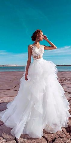 Top 24 Wedding Dresses For Celebration ❤️ a line illusion lace top ruffled skirt top wedding dresses versal wedding ❤️ See more: http://www.weddingforward.com/wedding-ideas-part-2/ #wedding #bride #bridalgown