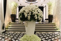 Orchids decoration in vase plus side white flowers compositions