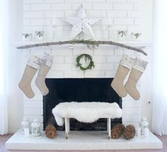 Love the rustic, white, holiday & Christmas decor. Incorporating the wood branch on the mantel is an awesome touch!