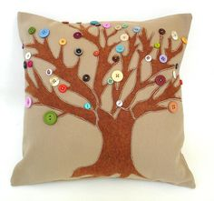 Button tree pillow.     One idea to inspire more if you collect loose buttons or the extras that come with your clothes!