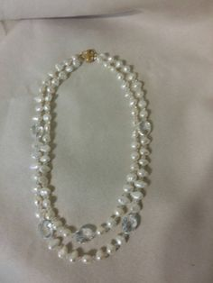 Check out this item in my Etsy shop https://www.etsy.com/listing/239845849/baroque-double-stand-freshwater-pearl