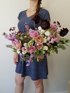 Summer wedding bouquet with purple, peach and burgundy flowers such as clematis, scabiosa and garden roses by Foraged Floral in Portland OR