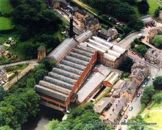 In this aerial view of the Luddenden Foot Mills of British Furtex, Burnley Road runs from top-left, Danny Lane is on the left, Luddenden Lane on the right, and Station Road across to the top-right.