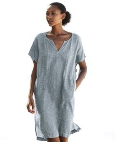 Soft woven linen with a subtle stripe generously cut in panels. With notch details at the neckline and deep sleeves, finished with two jetted side pockets. 100% linen