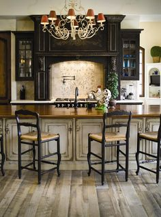 Six degrees of separation from a white kitchen! - The Enchanted Home This black cabinetry is accented with gray heavily distressed island and reclaimed looking wood floors to create an old world look, Habersham