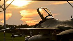 https://flic.kr/p/Mb4yZe | Oklahoma National Guard | SSgt Travis Reimer, of the Oklahoma National Guard's 138th Maintenance Squadron, awaits his pilot for night flying as the sun sets over the 138th Fighter Wing, Tulsa, OK, Aug. 10, 2016. (US Air National Guard photo by Tech. Sgt. Drew Egnoske)