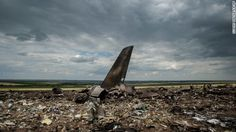 Debris lies scattered at an airport in Luhansk, in eastern Ukraine, on Saturday, June 14, after the crash of a Ukrainian Ilyushin-76 militar...