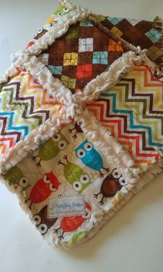 Hey, I found this really awesome Etsy listing at http://www.etsy.com/listing/78801462/rag-quilt-baby-boy-robert-kaufman-owls