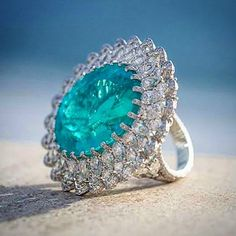 Chopard 2015 Haute Joaillerie collection  41.57ct Paraiba tourmaline surrounded by lacework ribbon of diamonds via @my.luxury.travel