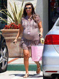 ump, there it is! Mom-to-be Kourtney Kardashian prepares for the arrival of her baby girl with a little shopping spree in Woodland Hills, Calif., on Tuesday.
