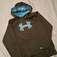 SALE! New! Under Armour Storm Hoodie Under Armour Storm. Perfect condition. Worn 1 time! Looks brand new. Feels super soft. The outside is slippery fabric as well as in the hood. The inside is fuzzy fleece. This is a YXL but it fits like a Woman's Med or Small. It's a steal at this price!! Under Armour Tops Sweatshirts & Hoodies