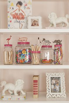 Cute jars for storage. Painted lids to match decor. Could add other objects such as knobs, for a mature theme. I would try vintage or wooden thread spool for sewing notions. Very cute!