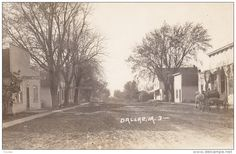 RP: main Street (dirt) , DALLAS , Iowa , 00-10s ; L.L. Cook Photo postcard
