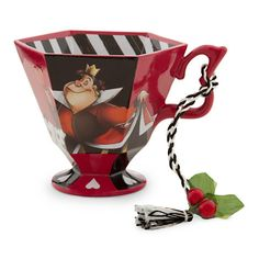 """New.  Queen of Hearts from Alice in Wonderland Teacup Disney Ornament.  Resin  2 3/4"""" H x 3 1/4"""" D x 4"""" W  Braided cord for hanging features holly and berries trim.  The Queen of Hearts and her card soldiers are the characters adorning the teacup."""