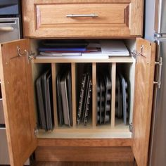 Dead Space In Kitchen Cabinets | Custom cabinet sized for baking pans and an ingenious use of dead ...