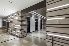Lift lobby / Wall design / Wall lighting at Shaw Centre Singapore by DP Design