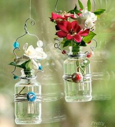 Hanging Beaded Glass Vases - This pretty vase craft project can be hung in front of windows, from a doorknob, on a wall or outdoors in a sheltered spot. Tutorial.