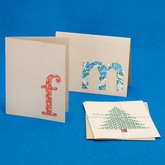 Super easy monogram cards. Find a font you like, print the letter in that font the size you want it, cut letter out, trace letter on fabric, glue onto plain card or card stock that's been cut and folded into a card.