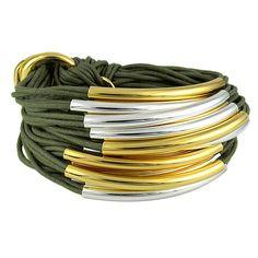 Gillian Julius Multi Tube Bracelet, Mixed Gold & Silver   Khaki Cord. Multi strand bracelet consisting of 20 waxed cotton cords. Each cord of bracelet features either a silver or iridium tube. $275