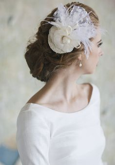 "Above All Else Headpiece 68.99 at shopruche.com. A cream chiffon clip hosts a pair of raw edge rosettes, delicate ivory plumage, and dotted swiss tulle for texture. Finished with delicate beading for the perfect hint of shimmer.  6.75"" wide, 2.5"" comb"