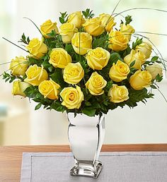 Nice  way to start saying  I am sorry Premium Long Stem Yellow Roses in Silver Vase