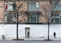 Brooklyn studio SO-IL has stretched a thin layer of white film over the facade of the Storefront gallery in New York, giving the building a vacuum-packed appearance.