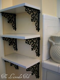 Scrolled brackets to add pizazz to plain shelves. Above the old sewing table,use for the printer?