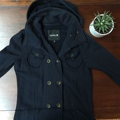 Hurley fleece pea coat Hurley fleece pea coat. Size medium. Good, used condition. This jacket was previously loved by me, but still has lots of life left. Navy blue fleece with detachable hood. Raw edge seams around waist and chest pockets. Button closure, two front pockets. Button tab details on sleeves. Some fading from wear. One loose thread on arm cuff, but can be fixed easily. 100% cotton. Hurley Jackets & Coats Pea Coats