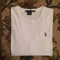 Polo Pocket Tee (long sleeve) Girls size small but fits like a women's XS. White 3/4 sleeve with a purple polo emblem on the pocket. Good condition. Polo by Ralph Lauren Tops Tees - Long Sleeve