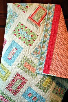 Rectangle quilt with pretty back.