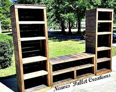 """RECYCLED WOOD PALLETS: This entire Entertainment set up is 105"""" long and 73"""" high. The two bookcases are 18"""" deep x 25"""" wide. The console table in the middle is is 54"""" wide x 18"""" deep. There is plenty of room for all the gaming systems, DVD's, and accessories that go along with a family room entertainment center. We sold the entire set up for $450 stained. Message us if you would like us to build a custom piece for you. Item #708"""