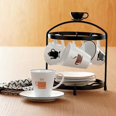 gifts for caffeine lovers: coffee addiction collection espresso cups and saucers are held perfectly in a cute stand. white porcelain with adorable coffee-inspired graphics in browns, black, and oranges. Espresso Cups, Home Hacks, White Porcelain, Kitchen And Bath, Cup And Saucer, Dinnerware, Tea Pots, Coffee Addiction, Mugs