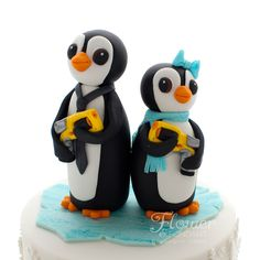 These adorable Nerf gun wielding Penguins adorned the top of an engagement cake.