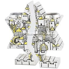 Stunning Star of David Candle Holders design from the Karshi studios of Jerusalem featuring the Old City Gates and buildings with the Montefiore Windmill and the edges of his candle holder having a Kotel (Western Wall) feel to it. Size: 5 inches approx.