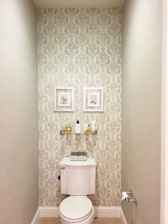 A gray and white stenciled bathroom accent wall using the Verde Damask Stencil from Cutting Edge Stencils. http://www.cuttingedgestencils.com/verde-damask-craft-stencil-DIY-home-improvement-project.html