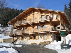 Secret Chalet - Haute-Savoie, France. Knock-your-socks-off views that stretch across the Giffre valley to the mountains of the Grand Massif and on to the Mont Blanc, best admired from the outdoor terrace hot tub: just the thing to soak weary muscles.