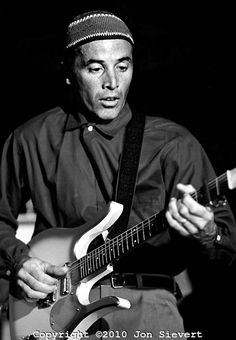 Ry Cooder, 6/25/83, San Francisco. American guitarist, singer and composer. He is known for his slide guitar work.