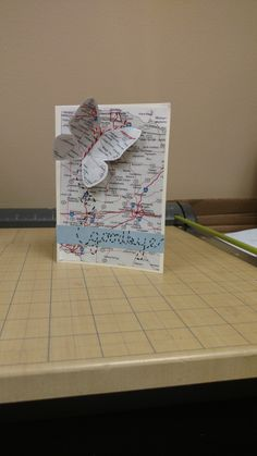 """Going away card custom made for a friend moving to Ohio. I printed out a map of Ohio to use as the background and butterfly. I glued the map onto cardstock to make the butterfly more sturdy then tied some bakers twine around the body to make antennas. Dashed from the butterfly to make the word """"goodbye""""  #goodbye #ohio #leaving #goingaway #diy #handmade #card #greeting #map #butterfly #custom"""