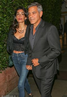 Night out: Work commitments took a back seat on Saturday evening as Hollywood couple George and Amal Clooney enjoyed a dinner date in Santa Monica.