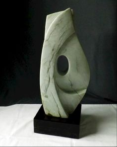 """Ahydrite Abstract sculpture on Black Marble base 16"""" high 31 Lb."""
