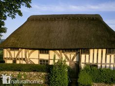 This is Alfriston Clergy House in East Sussex, England. Running along the end of the garden of this 14th century house is the Cuckmere River where water reeds grow. It's not surprising then that the house was thatched over the centuries with water reed which still forms the base coat of the thatch.
