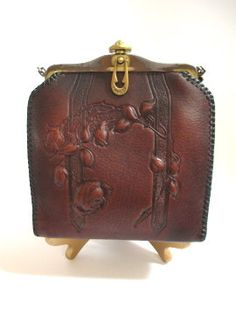 Arts and Crafts tooled leather purse by JemCo with rose vine motif, Patented 1918