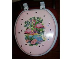 Bring a little deco style to your bathroom with this fabulous piece sporting a pair of vintage era retro1950s era flamingos. Nothing says