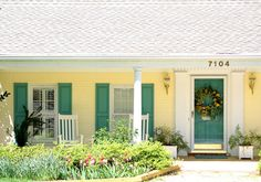Curb Appeal Photos with Colorful Front Doors.  Yellow exterior with green shutters and doors.
