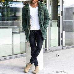 A green parka and black slim jeans are a perfect combination to be utilised at the weekend. Beige suede chelsea boots will add elegance to an otherwise simple look.   Shop this look on Lookastic: https://lookastic.com/men/looks/green-parka-white-crew-neck-t-shirt-black-skinny-jeans/22422   — White Crew-neck T-shirt  — Green Parka  — Black Skinny Jeans  — Beige Suede Chelsea Boots