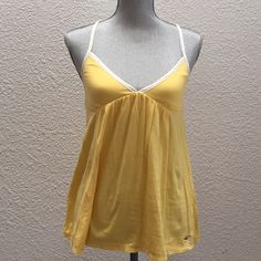 Hollister top in a sweet yellow 2/3 host pick! Sweet yellow Hollister tank. Worn once and in like new condition. Hollister Tops Tank Tops
