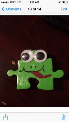 "Girl Scout Outdoor Frog SWAP. Painted puzzle piece with google eyes. Glue eyes to puzzle ""outie"" at top. Glue or duct tape safety pin to back."